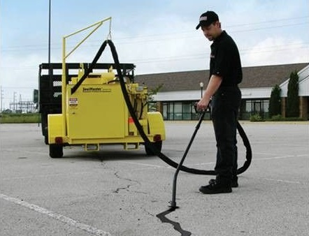 crack filling services save you money in the long term by extending the life of your asphalt