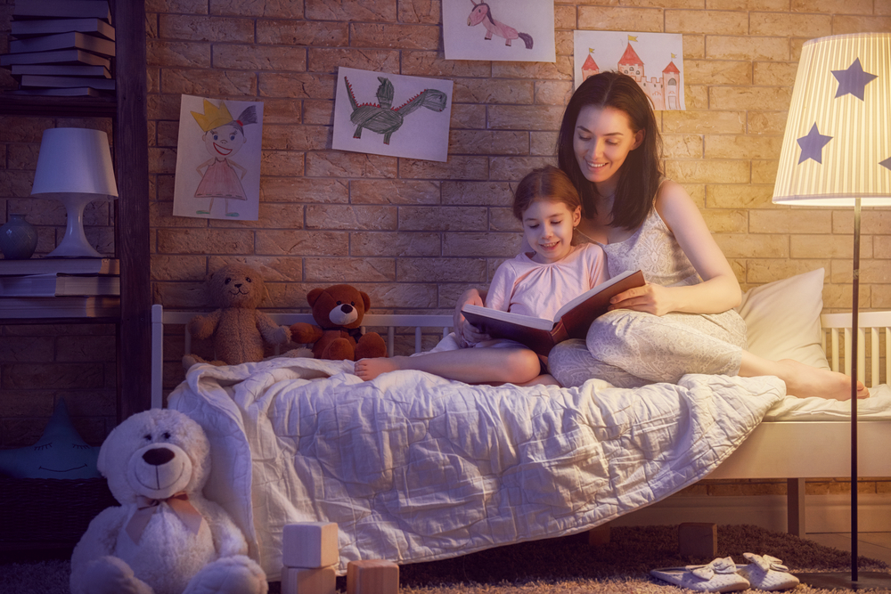 Mother-and-daughter-reading-before-bed