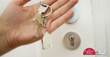 House keys with house keychain in someone's hand