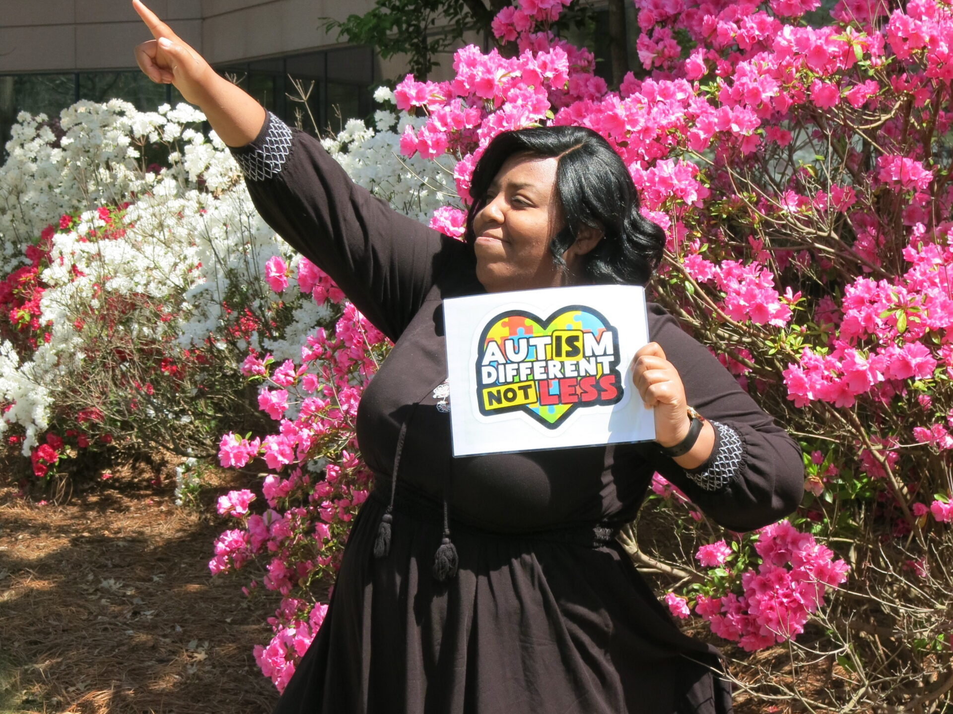 Tec-Masters' employee Chelsea Cueto holding a sign of encouragement for our Autism walk.