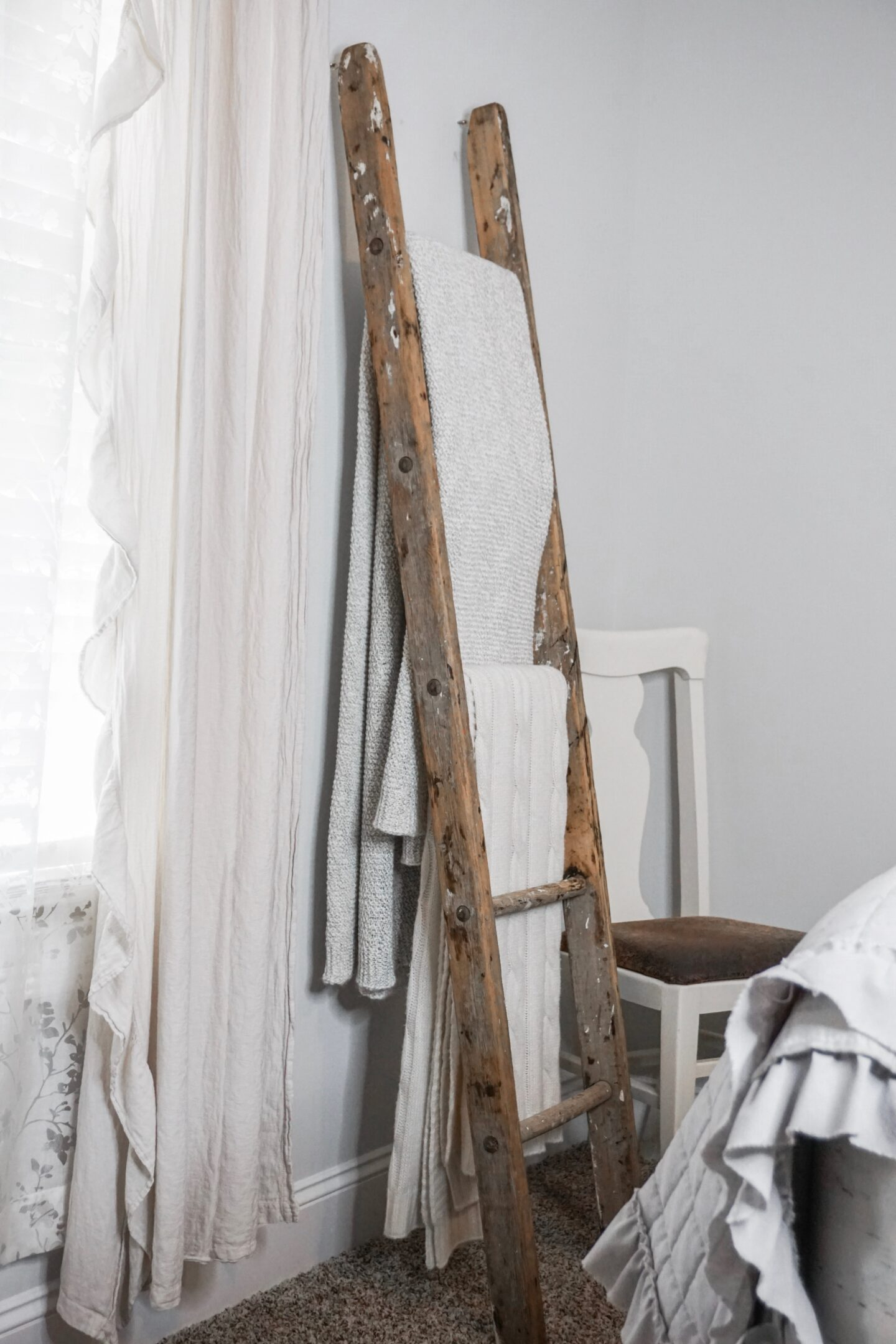 Farmhouse decorative blanket ladder anchored to the wall.