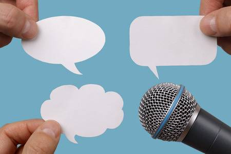 25636533-conference-interview-or-social-media-concept-with-microphone-and-blank-speech-bubbles