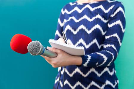 84212050-news-conference-female-journalist-