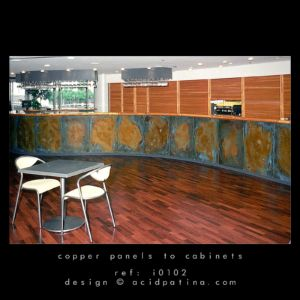 Bar front with decorative patinated copper panels