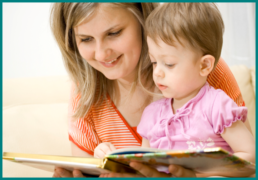 A mother reading a book to her toddler.
