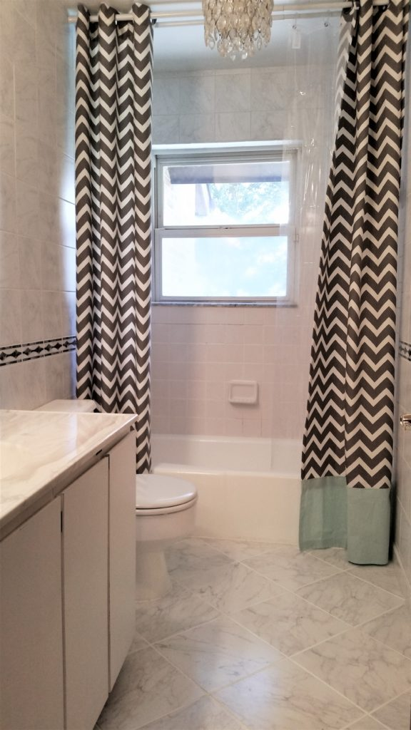 completed painted tub, tile and toilet