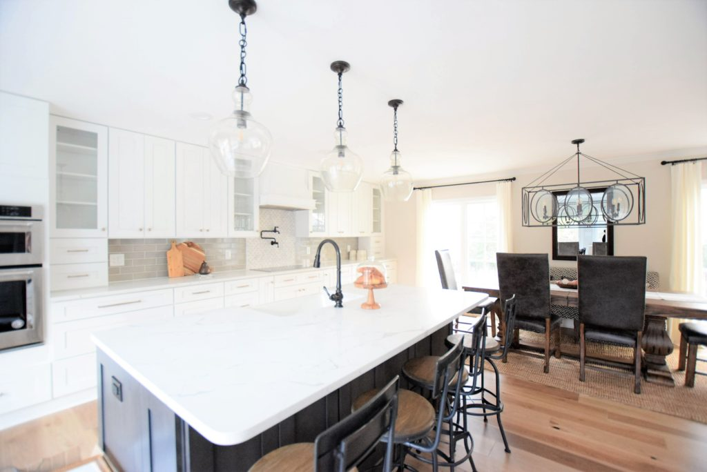 Ballard designs barstools Pottery barn pendant lights Calcatta laza Quartz by MSI,  ice white shaker cabinets, engineered wide plank flooring, Kitchen Aid Appliances, induction cooktop,