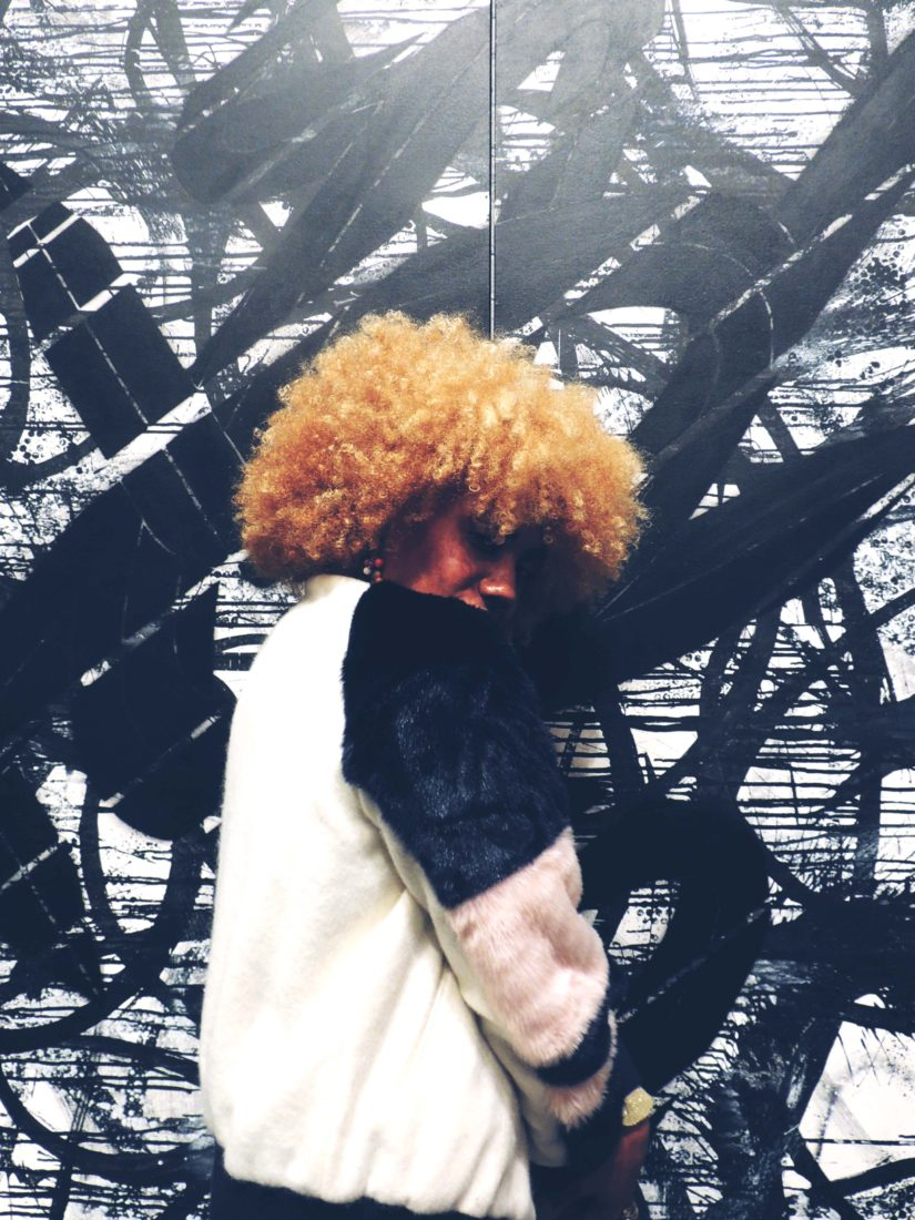 LiveClothesMinded at Onitsuka Tiger Pop Up in Soho wearing Zara Fur Jacket. Girl with big natural blonde hair.