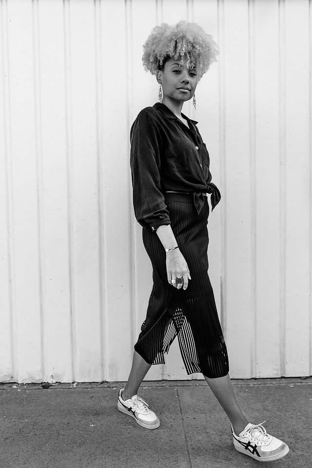 black and white photo of an athleisure outfit-thrift shirt-trendy skirt-liveclothesminded-fit femme