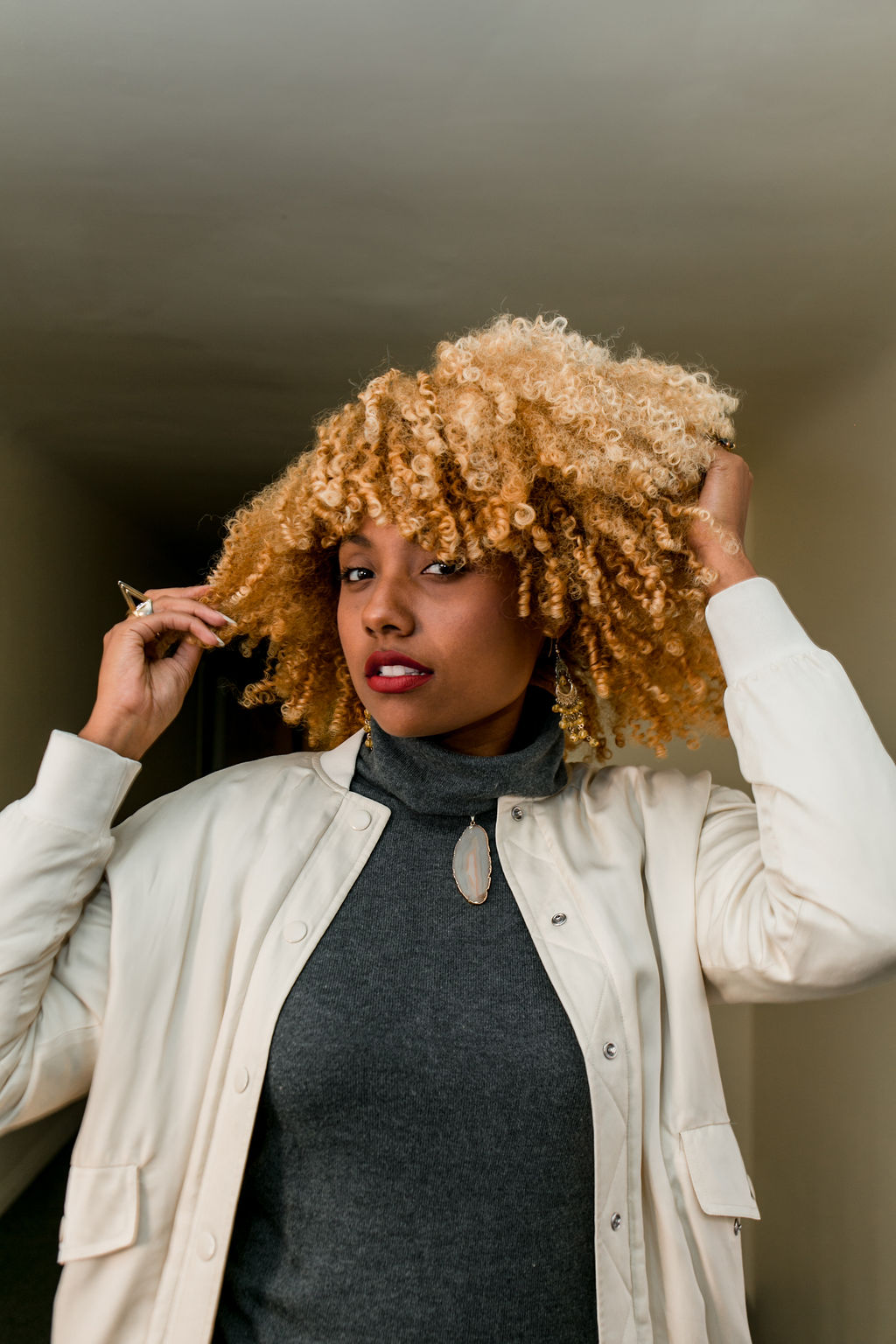 black woman with curly blonde hair