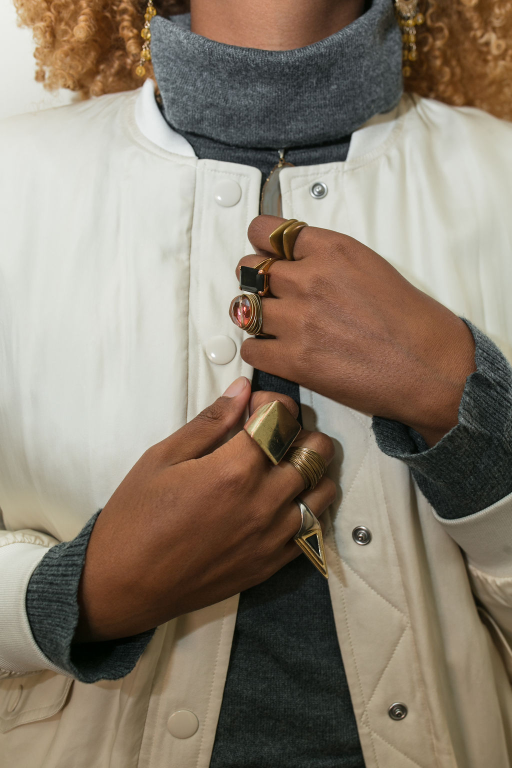 close up picture of rings on hands