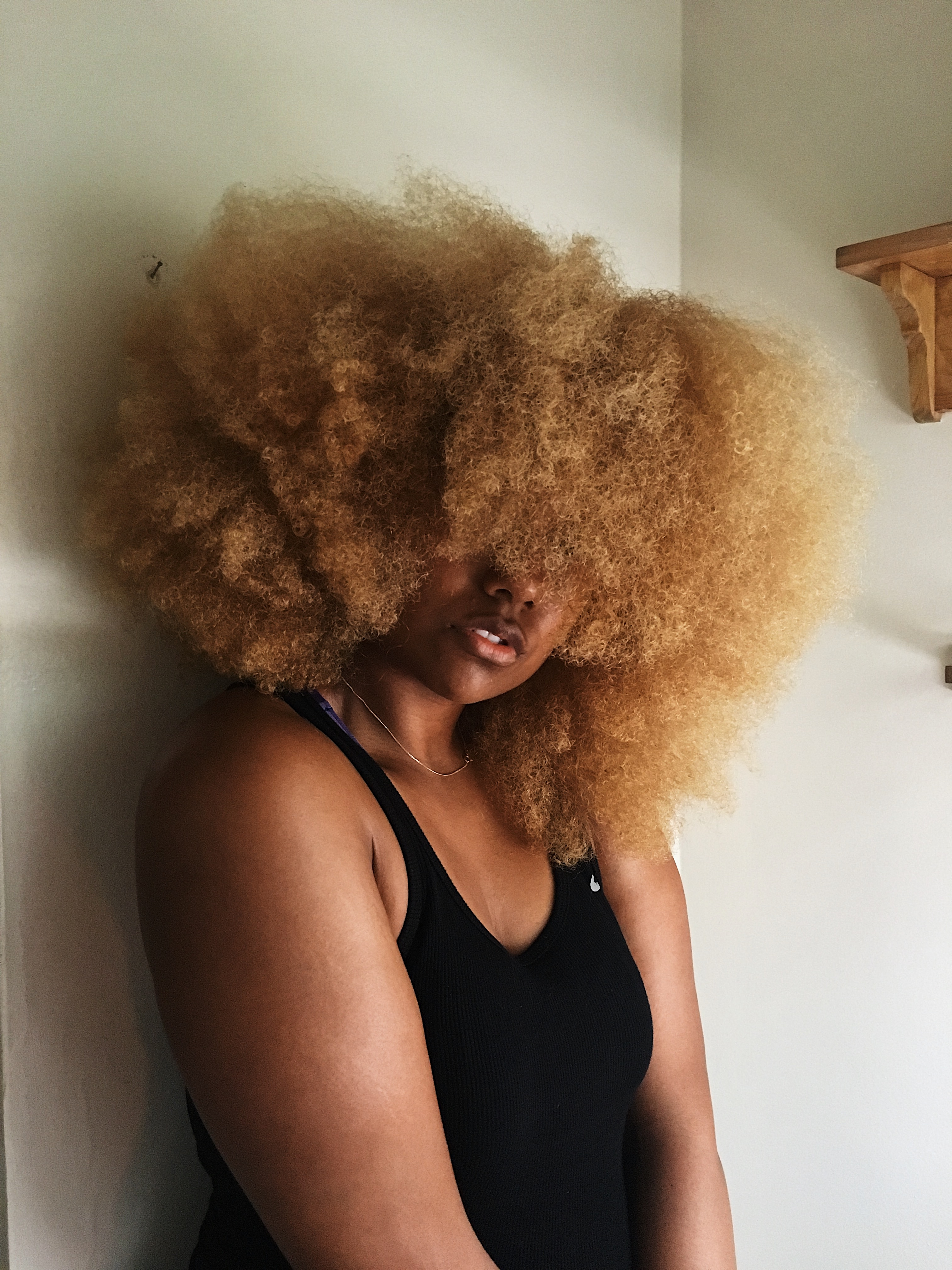 castor oil for natural hair-blonde afro