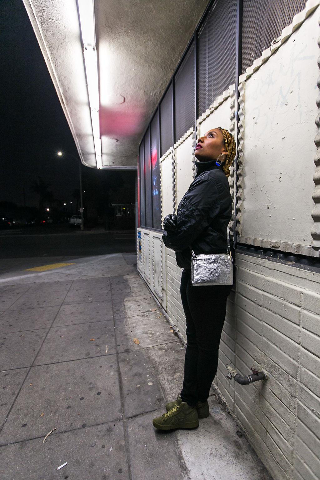 silver purse-black turtleneck-rsee-xmmtt-night photography-liquor store
