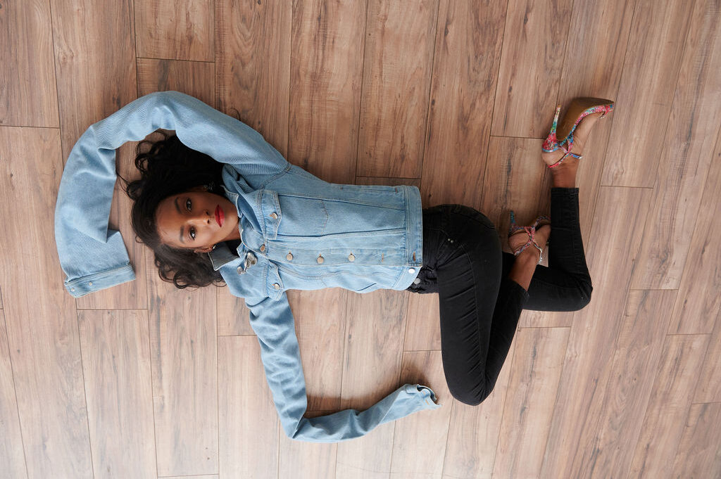 Annjulia Smalls In Y/Project-styled by melissa-lcm-sheldon botler photography-denim jacket-elongated sleeves-high fashion-model-hardwood floor