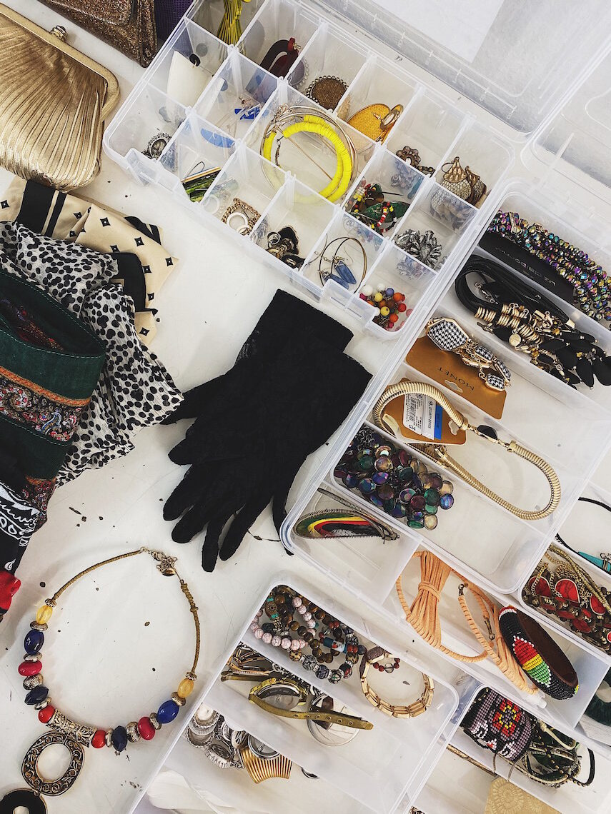 accessories-stylist-on set-gloves-necklaces-travel jewelry containers