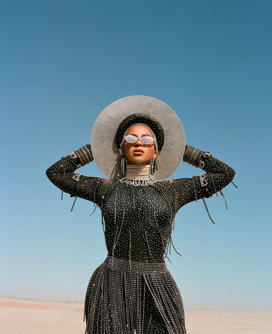beyonce.com-disney-black-is-king-find-your-way-back-bodysuit-skirt-d-bleu.dazzled-headpiece-hoop-earrings-sunglasses-a-morir-diamond-choker-area