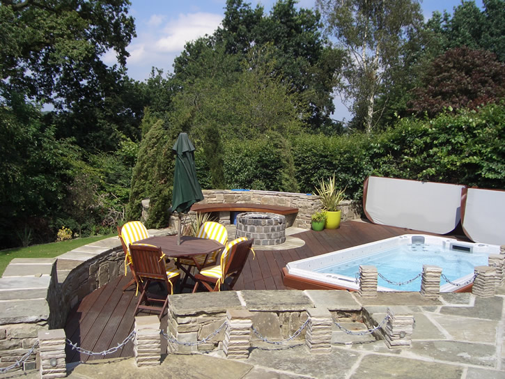 swim-spa-installed-in-deck-with-covers-off-sunny-day
