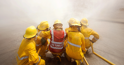 Five firefighters training during disaster planning.