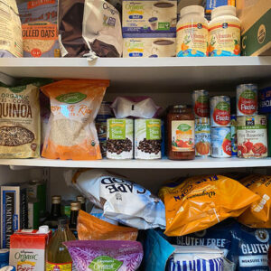 WOODBRIDGE, NEW JERSEY / USA - March 28, 2020: Dried and shelf stable food items are stored in a residential pantry, in preparation for potential Coronavirus quarantine in this illustrative editorial image.
