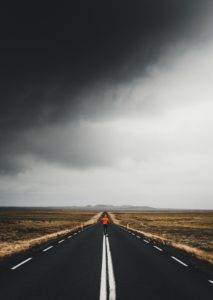 Person running on an open road