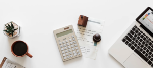 A top-down photo of a calculator on a desk, representing a PWin Calculator.