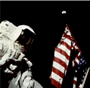 An Astronaut in space with an American Flag