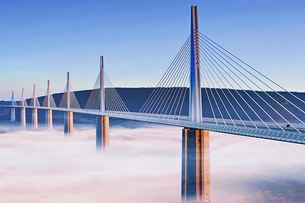 Bridge above the clouds with a blue sky