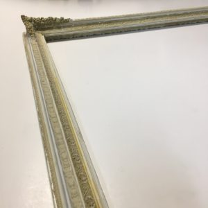 Ornamental picture frame restoration with compo repair detail