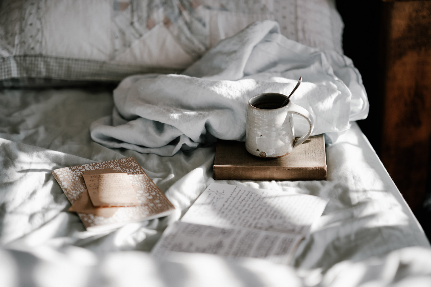 Bed with journal and tea insomnia