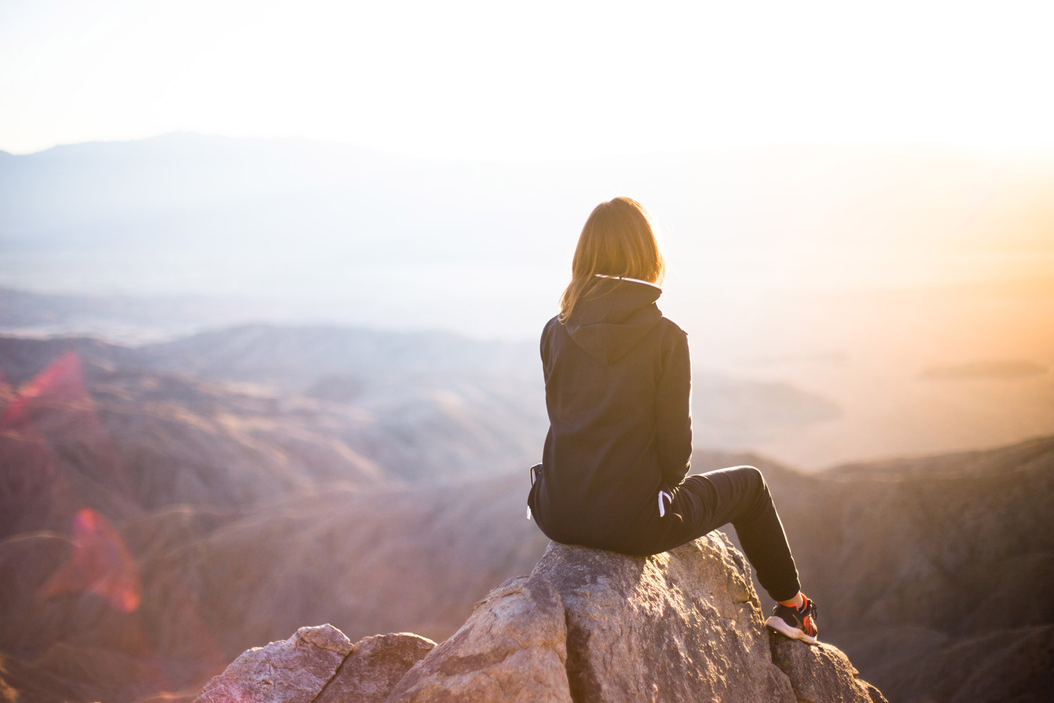 Woman sitting on rock help Anxiety Stress Burnout
