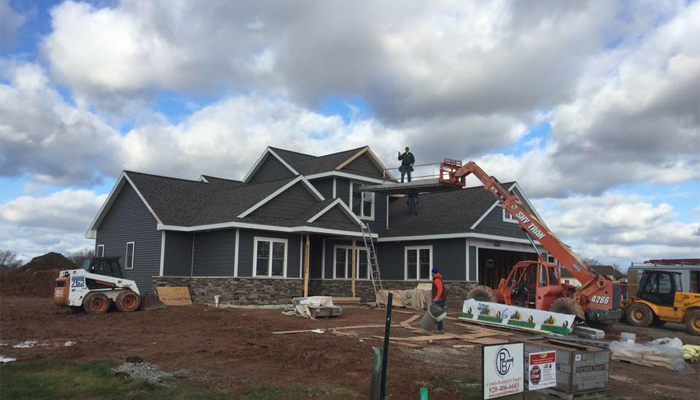 Exterior construction being done on custom home