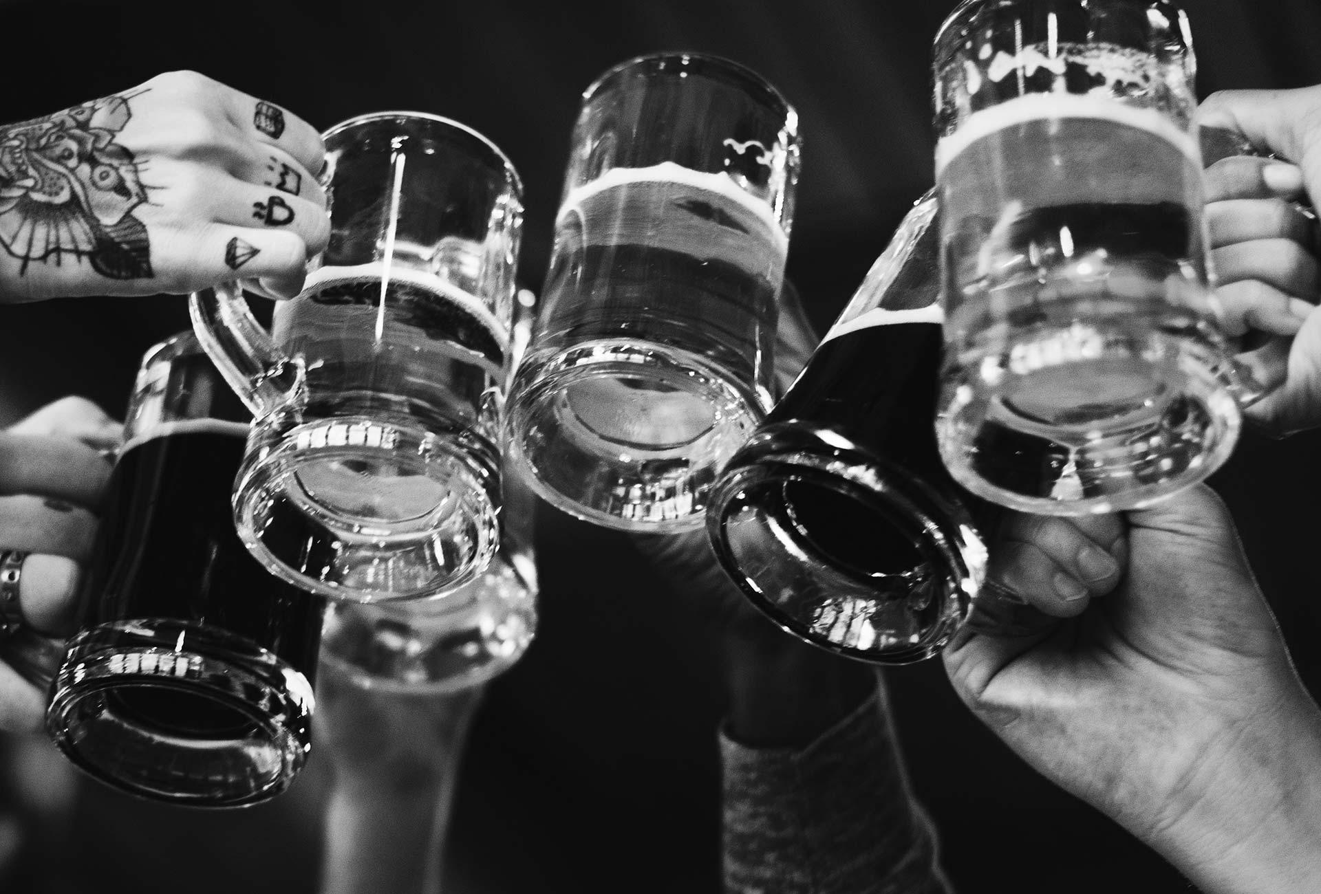 Beer mugs clinking together