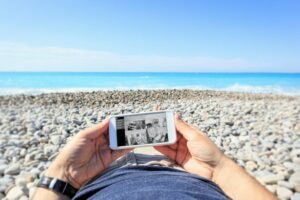 Watching video of business from the beach