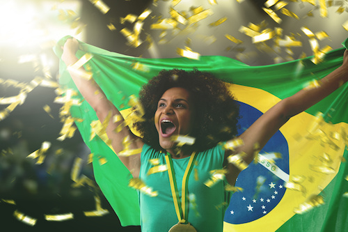 Female Athlete Holding The Brazilian Flag In The Stadium
