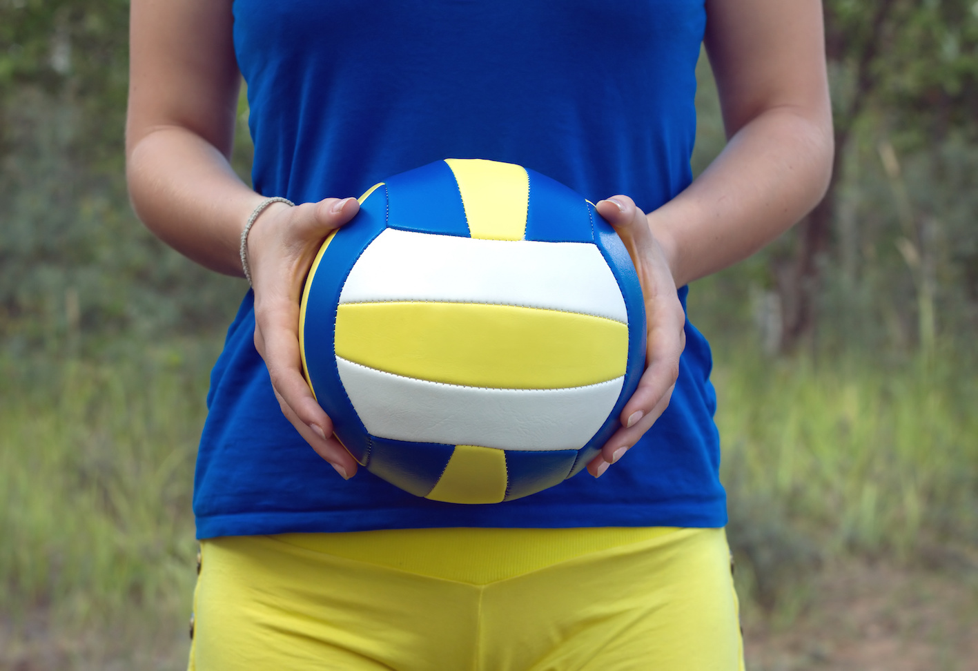 Girl Holding A Colorful Sports Ball For Volleyball Closeup