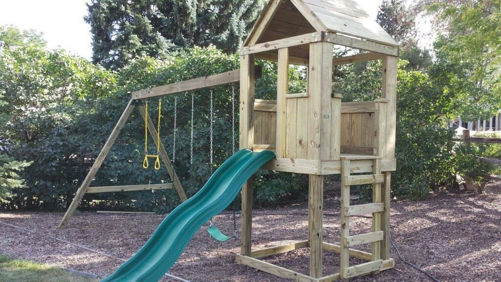 4'x4' Clubhouse with wooden roof, 4' Deck height, Standard slide, Ladder entry, 12' Swing beam with 2 Standard swings & Trapeze bar