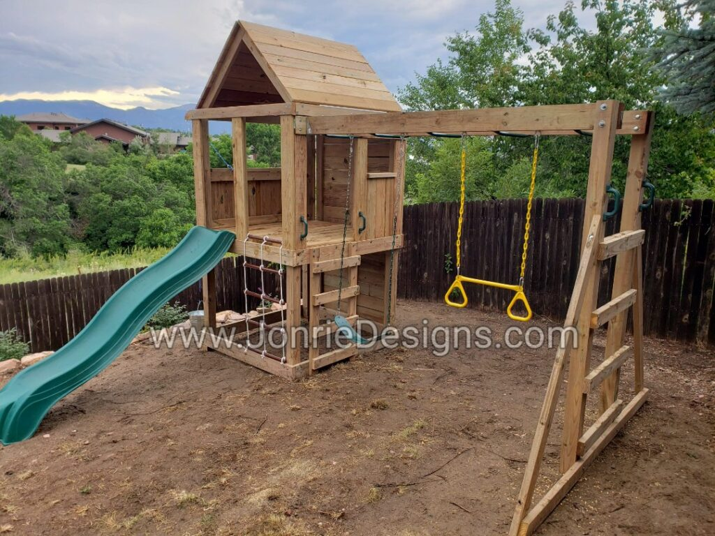 5'x5' Clubhouse with wooden roof, 4' Deck height, Upgraded slide, 2' Cargo net, 8' Climbing wall, 8' Monkey bars with Standard slide, Trapeze bar & Bucket drop