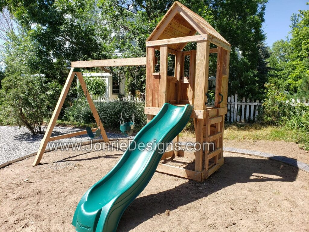 4'x4' Clubhouse with wooden roof, 4' Deck height, Upgraded slide, Ladder entry, Rock wall entry, 8' Swing beam, Standard swing & Bucket swing