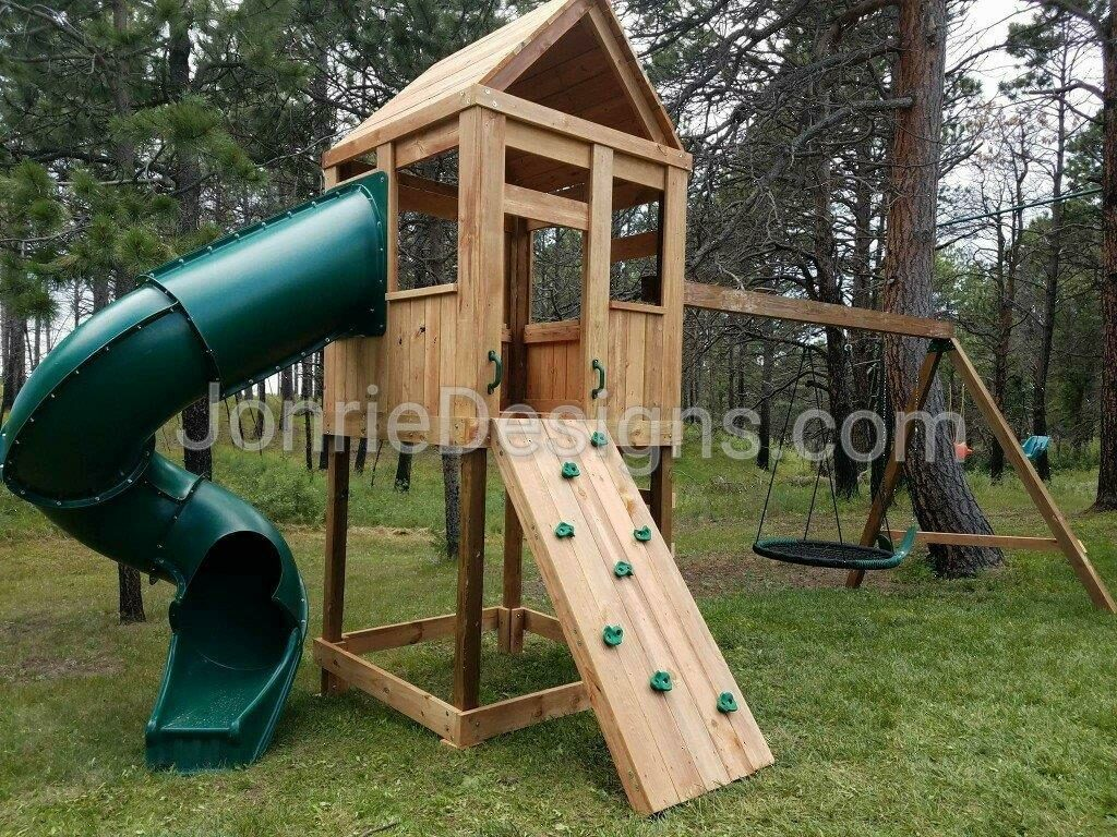 5'x5' Clubhouse with wooden roof, 5' Deck height, 7' Enclosed spiral slide, Ladder entry, Rock wall entry, 8' Swing beam with Standard swing & Web swing