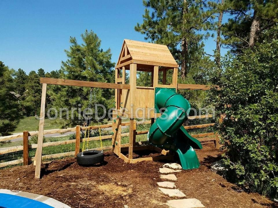 5'x5' Clubhouse with wooden roof, 5' Deck height, 5' Enclosed spiral slide, 5' Standard slide, 8' Monkey bars with dual ladders, Vertical rock entry, 8' Swing beam with Swivel Tire Swing