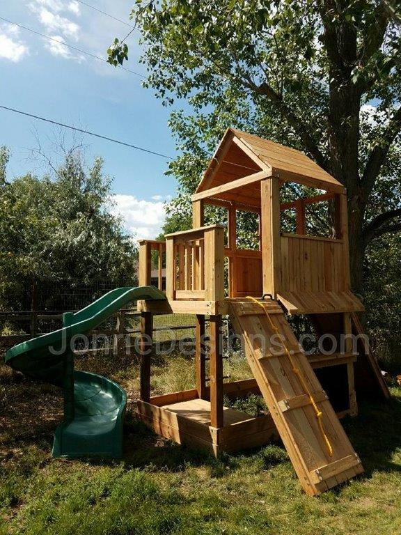 5'x5' Clubhouse with wooden roof, 3'x5' Uncovered porch with baluster rails (5'x8' Footprint), 5' Deck height, Open spiral slide, Rock wall entry, Rope wall entry & Lemonade stand