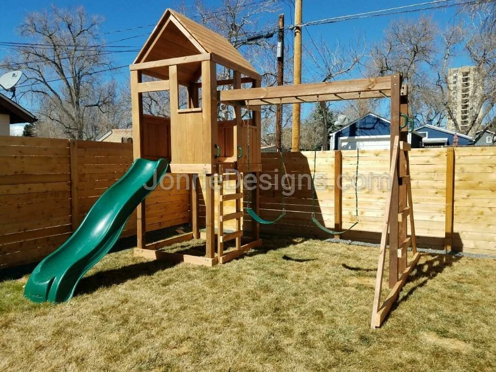 5'x5' Clubhouse with wooden roof, 5' Deck height, 5' Standard slide, 8' Monkey bars with dual ladders & 2 Standard swings