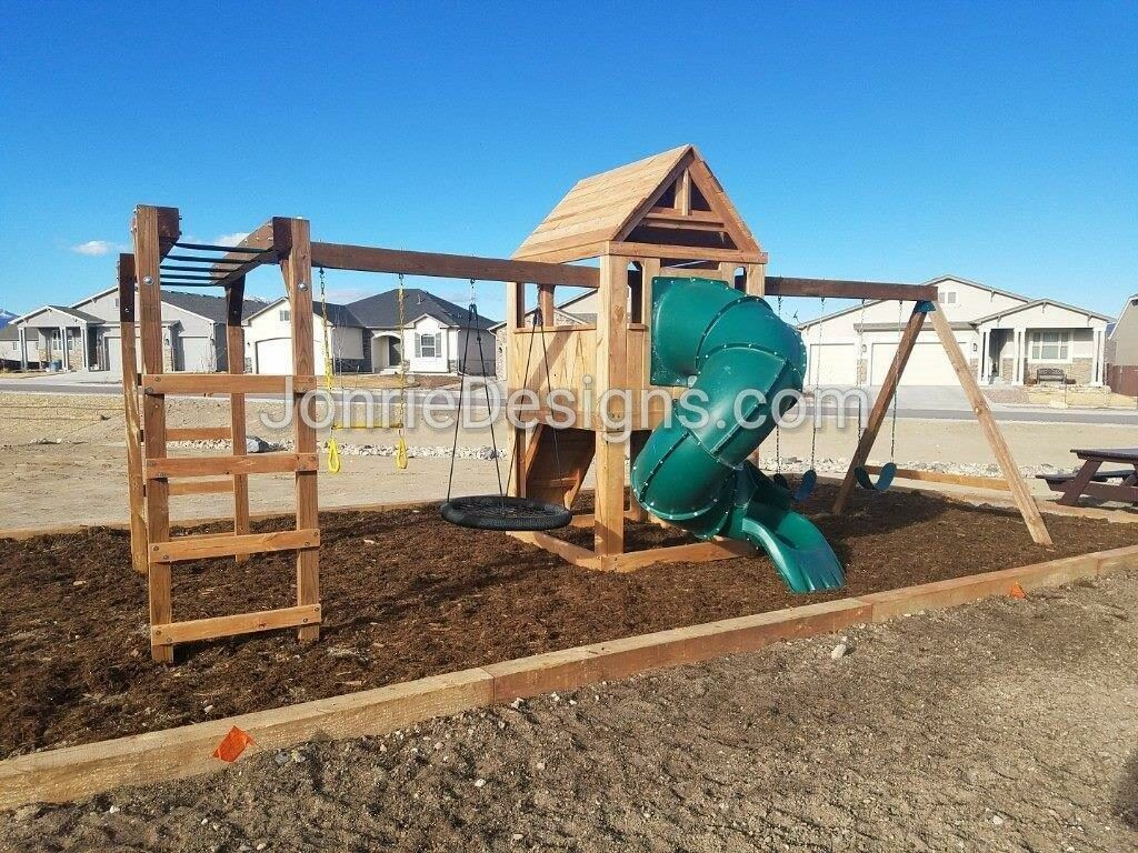 5'x5' Clubhouse with wooden roof, Rock wall entry, 5' Enclosed spiral slide, 2-8' Swing beams, 8' Monkey bars with dual ladders, 2 Standard swings, Trapeze bar & Web swing