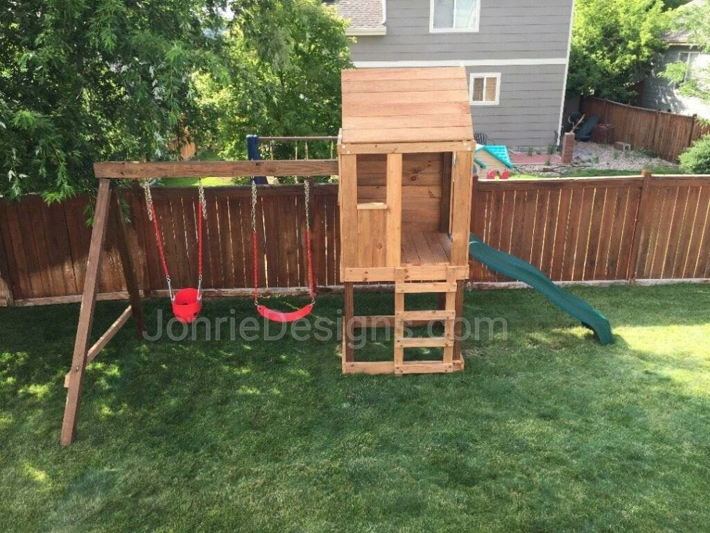 4'x4' Clubhouse with wooden roof, 4' deck, 4' Standard slide, Ladder entry, Red standard swing & Red Bucket swing