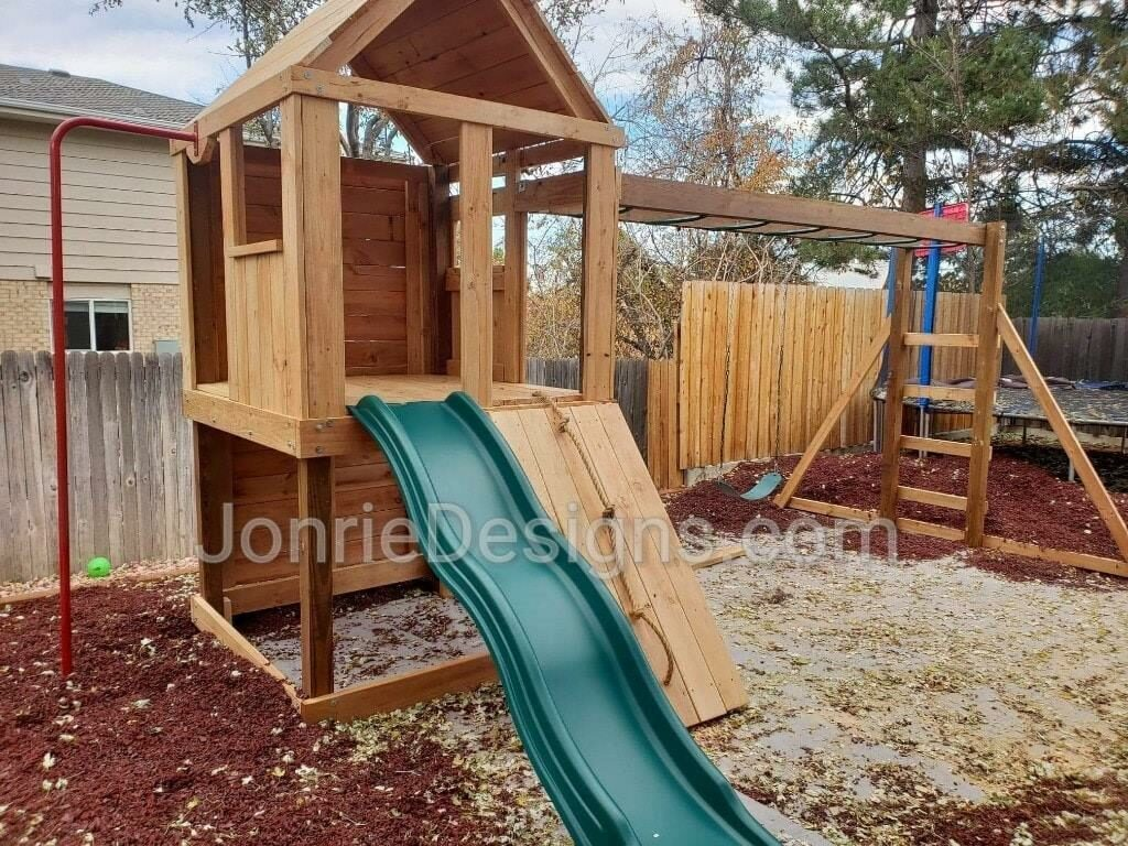 5'x5' Clubhouse with wooden roof, 4' Deck height, 4' Standard slide, Rope wall entry, 8' Climbing wall, Fireman pole, 12' Monkey bars with dual ladders with 3 Standard swings.