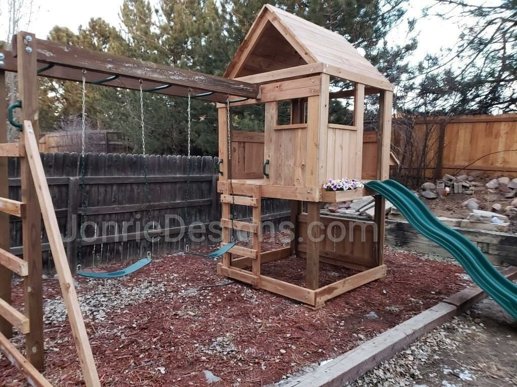 5'x5' Clubhouse with wooden roof, 4' Deck height, Lemonade stand, 4' Standard slide, 8' Monkey bars with dual ladders, 2 Standard swings & Flower Planter