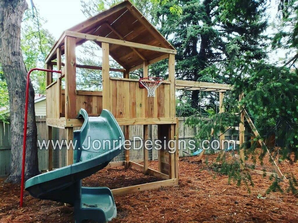 8'x8' Clubhouse with wooden roof, 5' deck height, Fireman pole, 8' Monkey bars with ladders & rock wall entries, Basketball hoop, 5' Open Spiral Slide