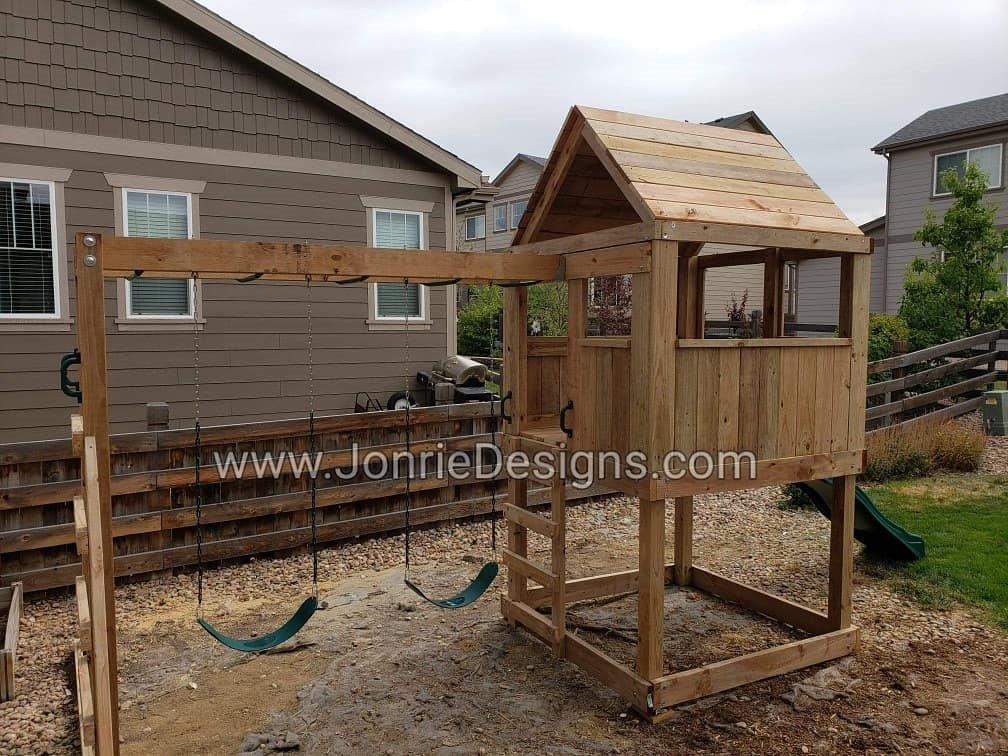 5'x5' Clubhouse with wooden roof, 4' Deck height, 4' Standard slide, 8 Monkey bars with dual ladders & 2 Standard swings.