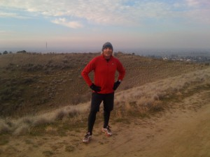 Thanksgiving 10K run - Taking a break on the trail.  The Idaho State Veterans' Cemetery flag is in the background.