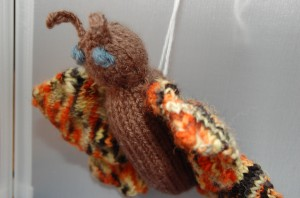 mothra made out of yarn knit